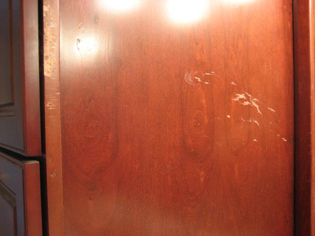 Scratches and gouges on linen cabinet side