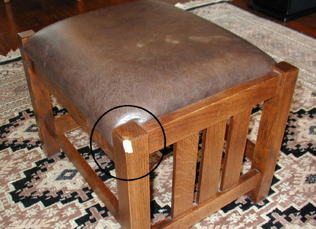 Stickley footstool with large chip