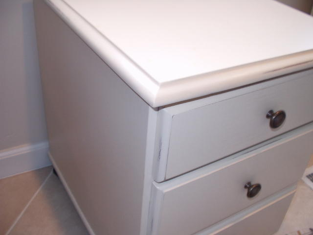 White lacquer cabinet after rebuilding and finishing broken corner